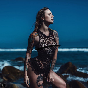 alysha nett, female model, woman on beach in front of coastline