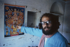 allen ginsberg kolkata BENARES, INDIA - FEBRUARY 1963: Beat poet Allen Ginsberg points at art poster during February 1963 in his tenement apartment near the banks of the Ganges river in Benaras, India. Ginsberg explored Eastern philosophies with Peter Orlovsky and other founders of the Beat movement during his March '62 - May '63 stay. (Photo by Pete turner/Getty Images)
