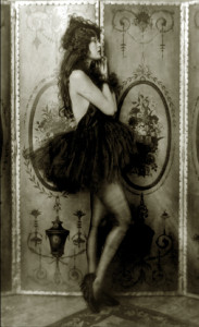 Ziegfeld girl posing with a dress