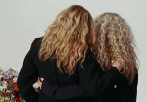 Proenza Schouler's video, women with their backs to us and their arms around each other