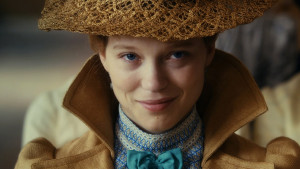 diary of a chambermaid movie, Jeanne Moreau wearing a beige hat and coat, with a blue bowtie