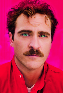 joaquin phoenix,, with green eyes wearing a red shirt, her film