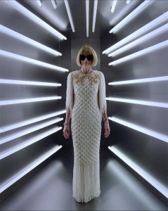 anna wintour in white dress surrounded by white lights