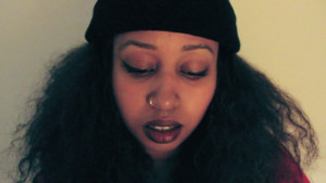 warsan shire portrait, lemonade poet, woman with nose ring and beanie