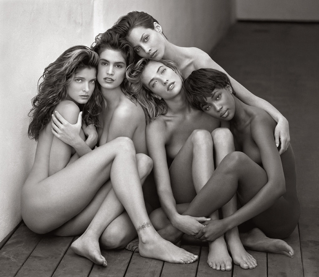 5 nude women embrace by Herb Ritts