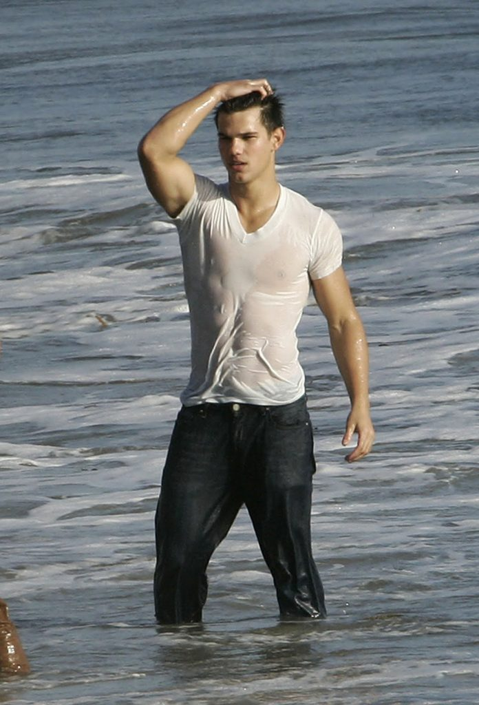 Taylor Lautner looking sexy in a wet white t-shirt