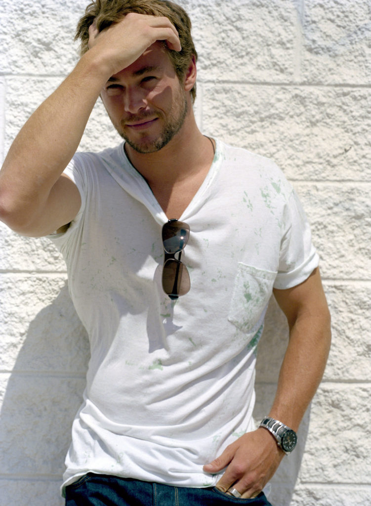 chris hemsworth looking sexy wearing a classic white t-shirt