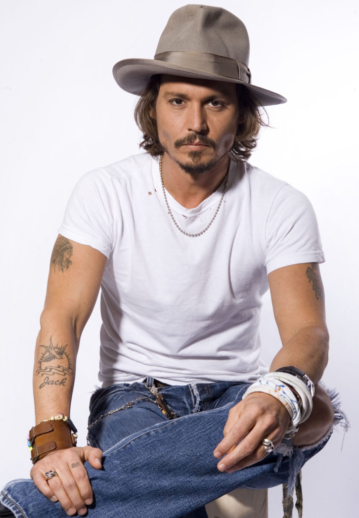 johnny depp wearing a fedora and classic white t-shirt