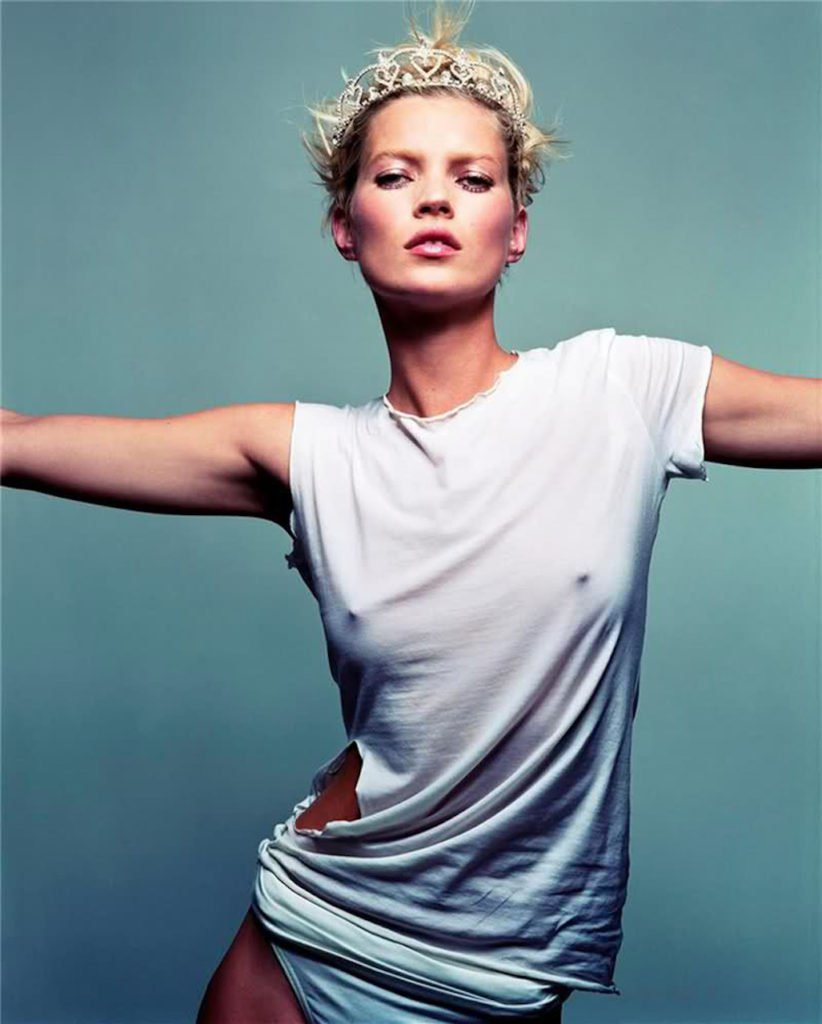 kate moss wearing a tiara and white t-shirt bra-less