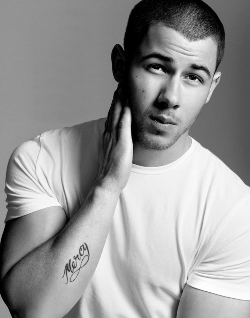 nick jonas wearing a classic white t-shirt
