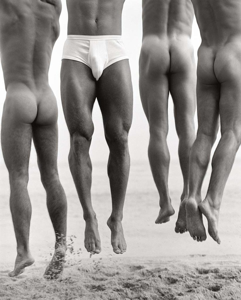 Nude men jumping on beach by HerbRitts