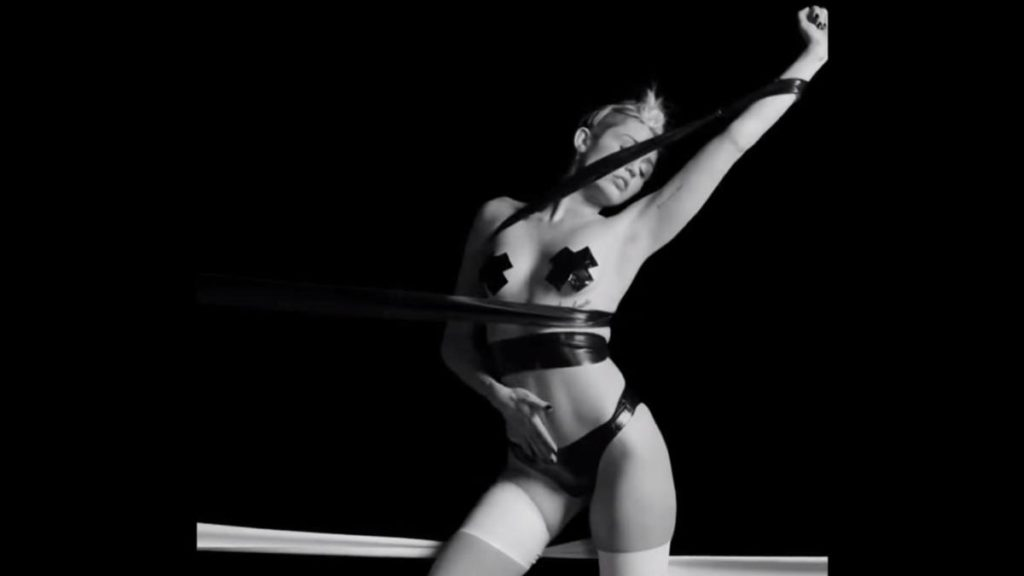 Miley Cyrus in a sexy provocative S&M scene in a Quentin Jones Film