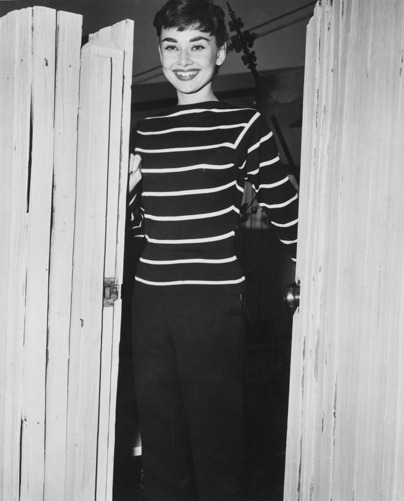 Audrey Hepburn wearing a Breton wool sweater originally worn by the fishermen from Brittany.
