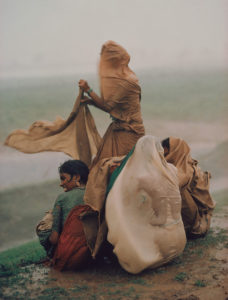 Raghubir Sing photograph of women caught in monsoon rain storm