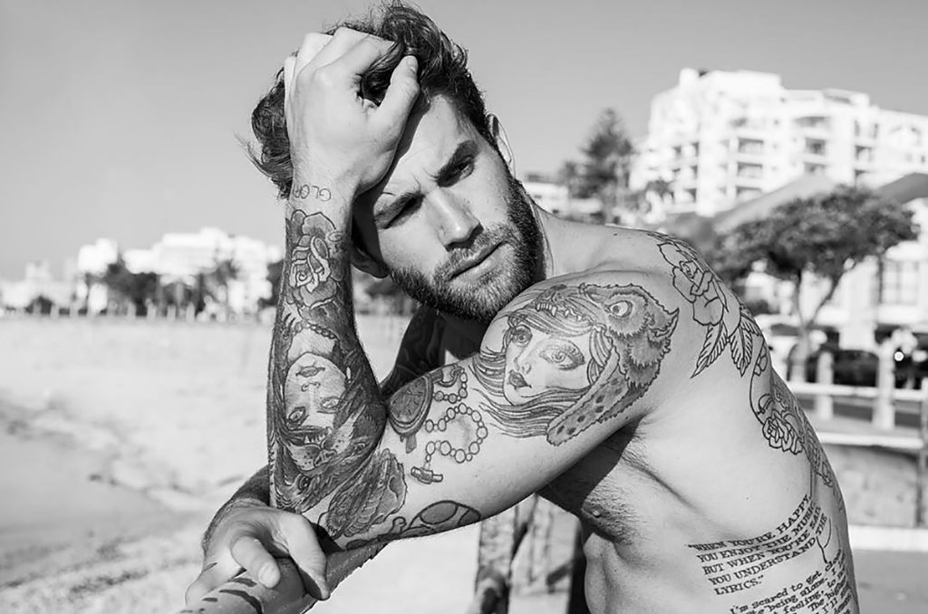 Photograph of Model Andre Hamman shirtless on the beach, June 2016