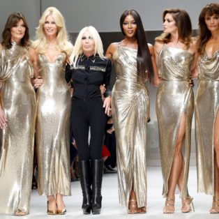 Photograph of blockbuster tribute runway show to Gianni Versace that ended with Donatella and five of the original supermodels – Cindy Crawford, Naomi Campbell, Claudia Schiffer, Helena Christensen and the former French first lady Carla Bruni – taking to the catwalk together, ...