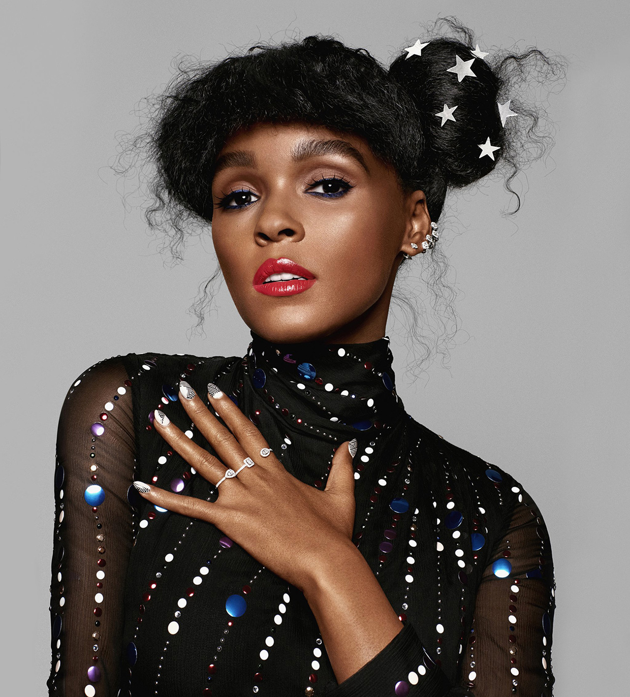 Janelle Monae hair in bun with stars