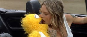 Tove Lo kissing muppet in car