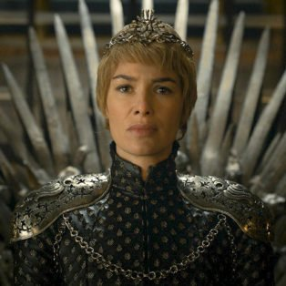 Photo of Lena Headey as Cersei Lannister, the sexiest female villian in HBO Series Game of Thrones- sitting on the throne with short cropped blonde hair wearing a crown.