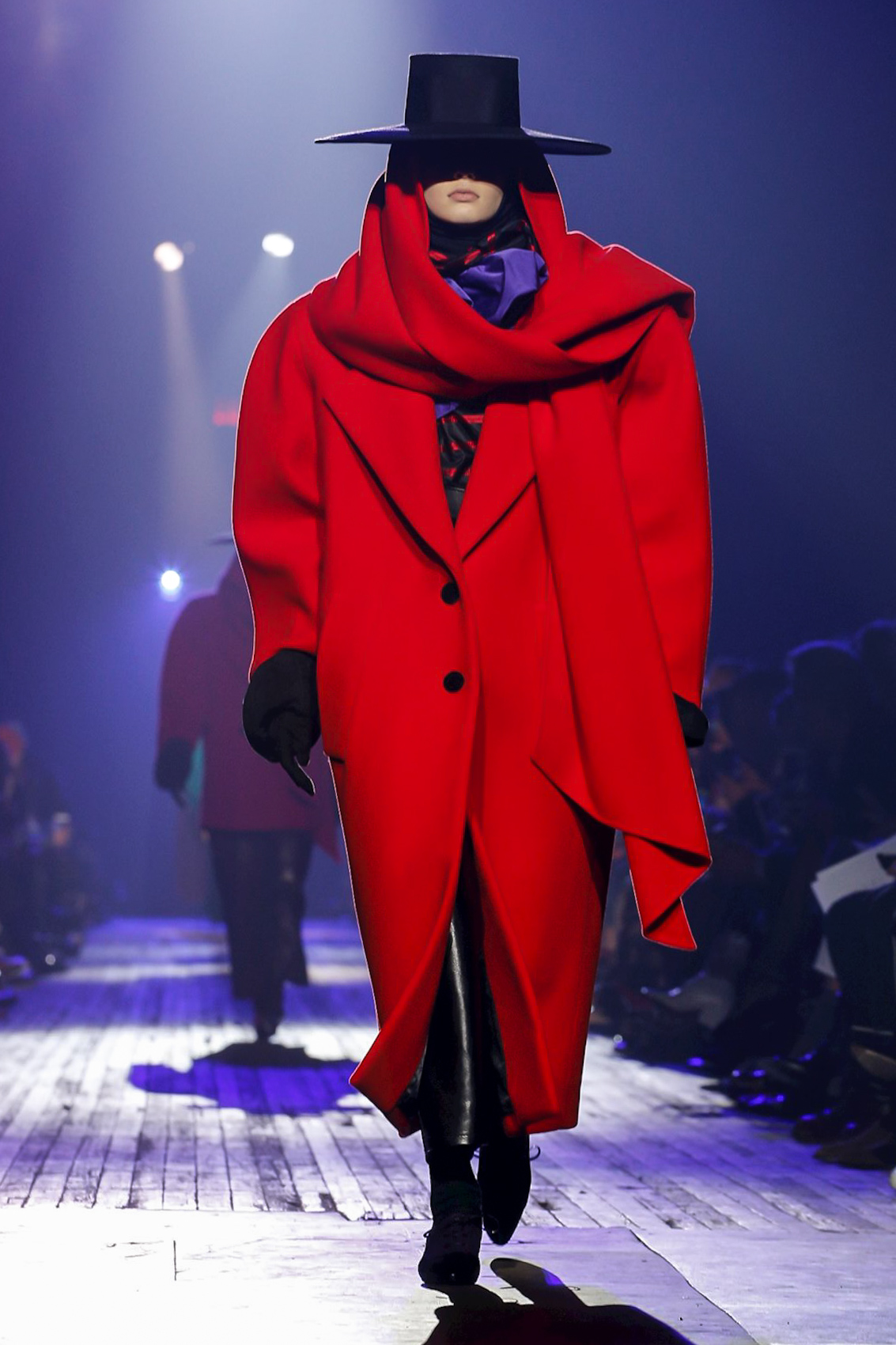 Photo of model in oversized red coat and flamenco black hat from Marc Jacobs Runway Show featuring Marc Jacob's Ready to Wear Collection for Fall/Winter 2018 in NYC