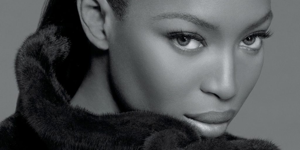 Black and White Photograph of Naomi Campbell's Beautiful Face With a Luxurious Fur Collar
