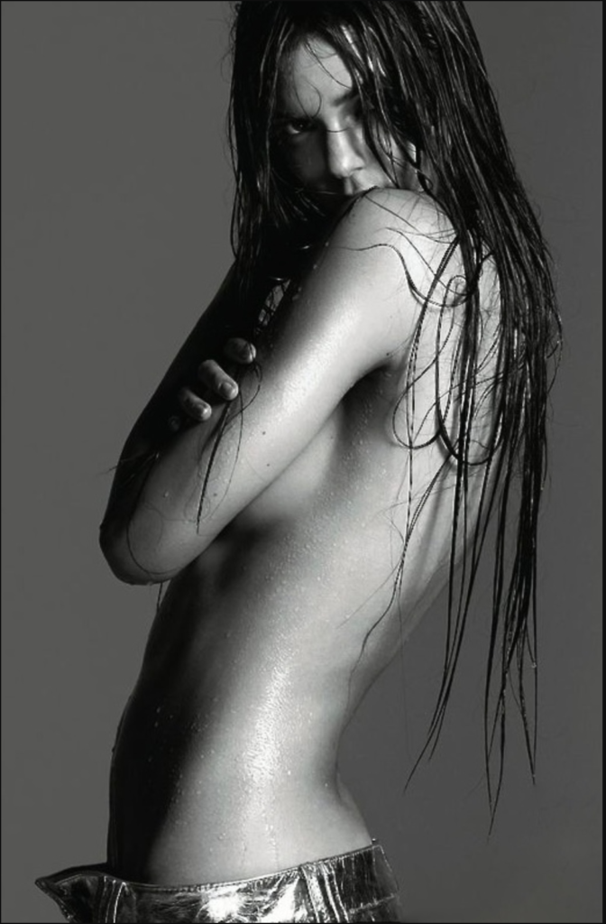 Sexy photograph of Kendall Jenner with wet hair and naked side view