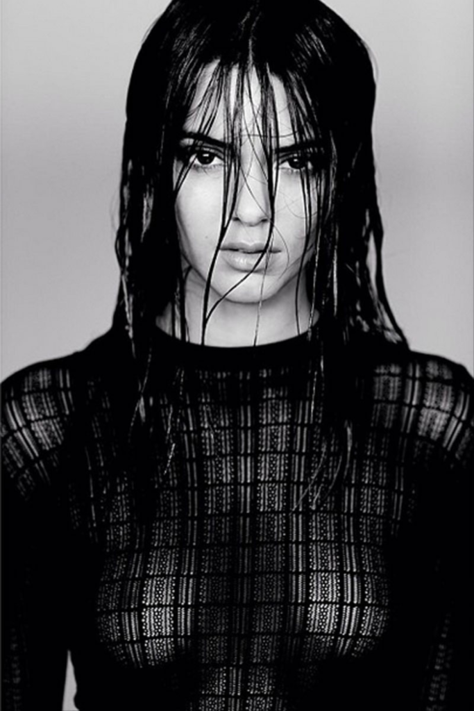 Sexy black and white photograph of Kendall James wearing a see-through shirt by photographer Russell James
