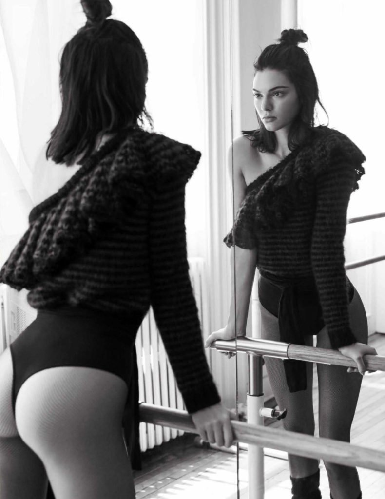 Photograph of Kendall Jenner looking in a mirror holding on to a ballet dance bar