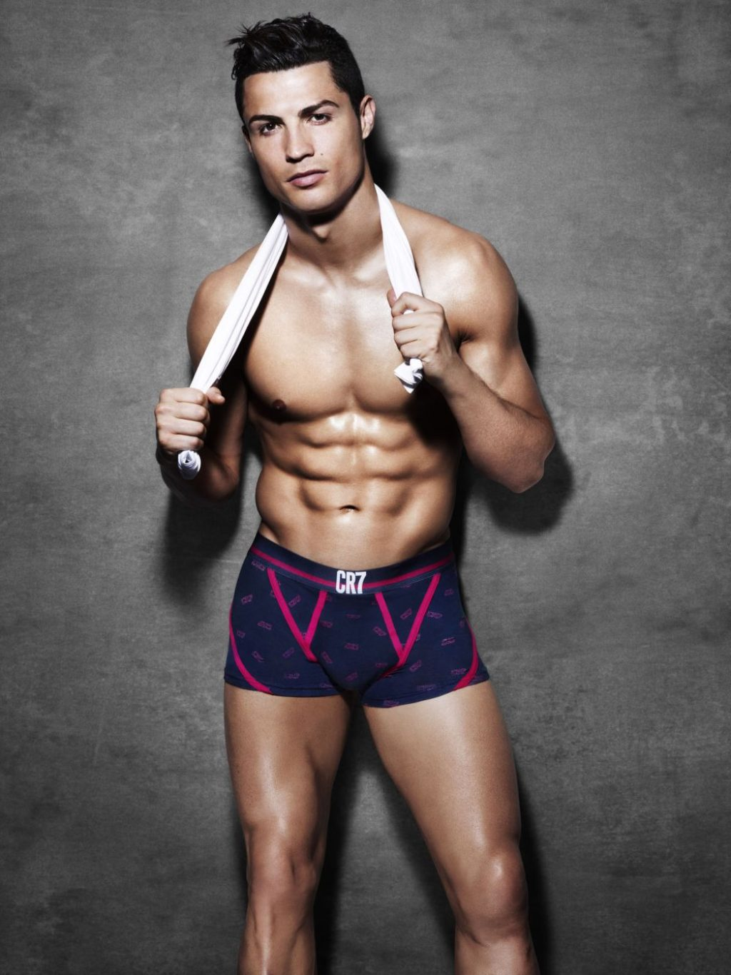 Cristiano Ronaldo looking smoking hot with 6-pack abs and tight blue and pink CR7 briefs