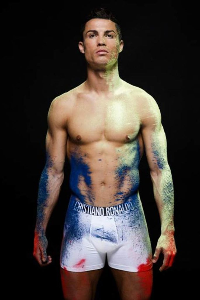 Photograph of Soccer Star Cristiano Ronaldo wearing white tight boxes with spray paint on his undies and body
