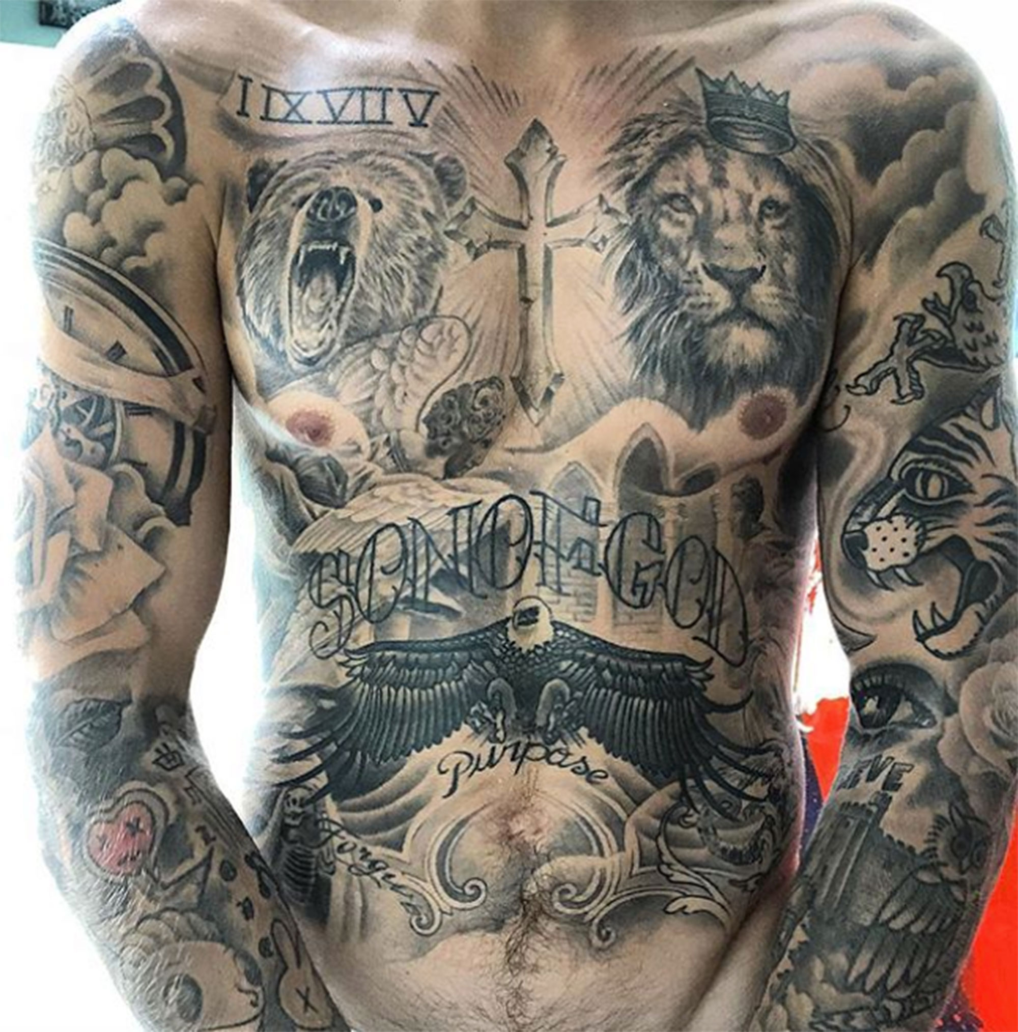Justin Bieber's sexy chest and arm tattoos by Tattoo Artist Bang Bang