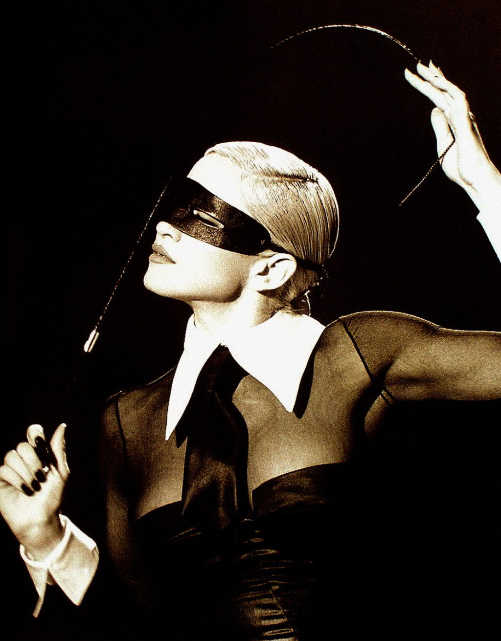 Madonna Erotica Wearing A Mask and Holding a Whip