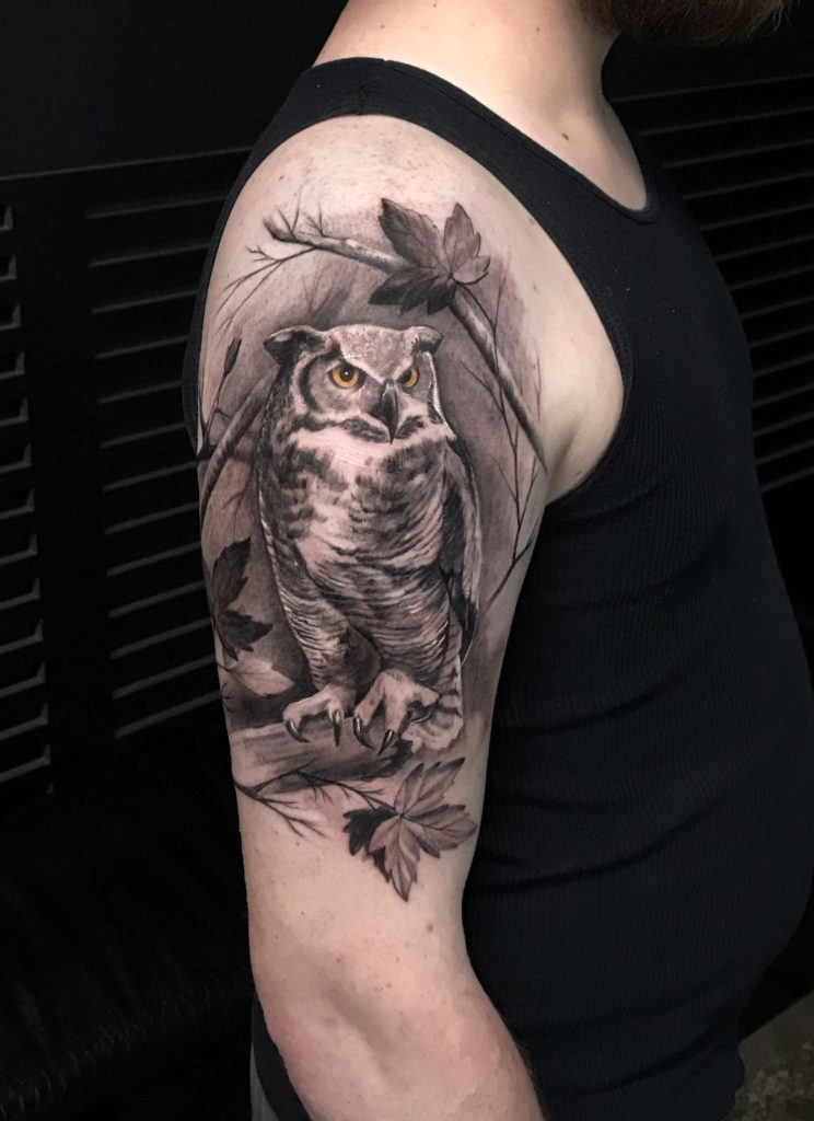 The most amazing tattoo of an owl on a man's arm by tattoo artist bang bang