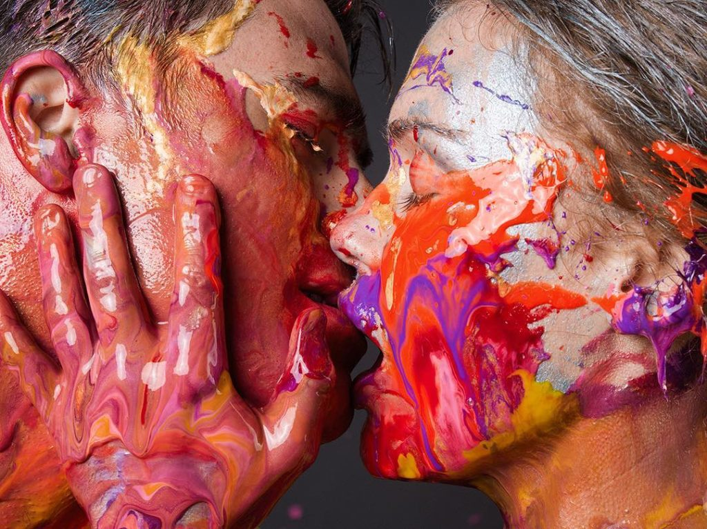 Photographer Tyler Shields Photograph of a couple kissing with paint dripping down their faces and hands