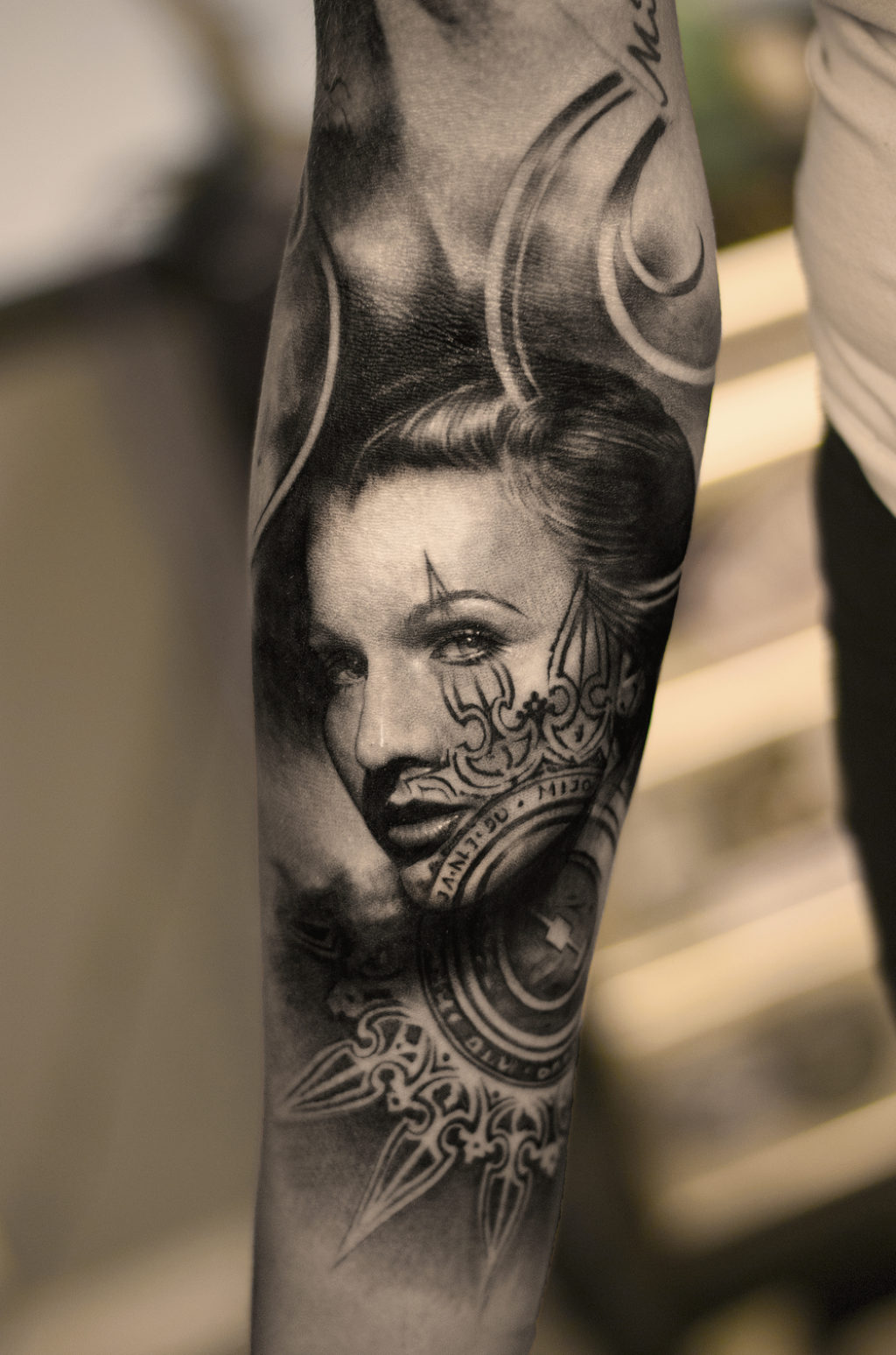 One of the most amazing Bang Bang Tattoos of a beautiful woman on a man's arm
