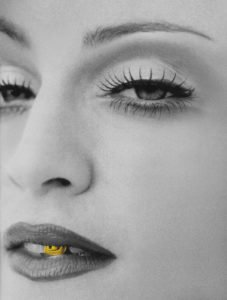 Black and White portrait of madonna with gold front tooth tooth