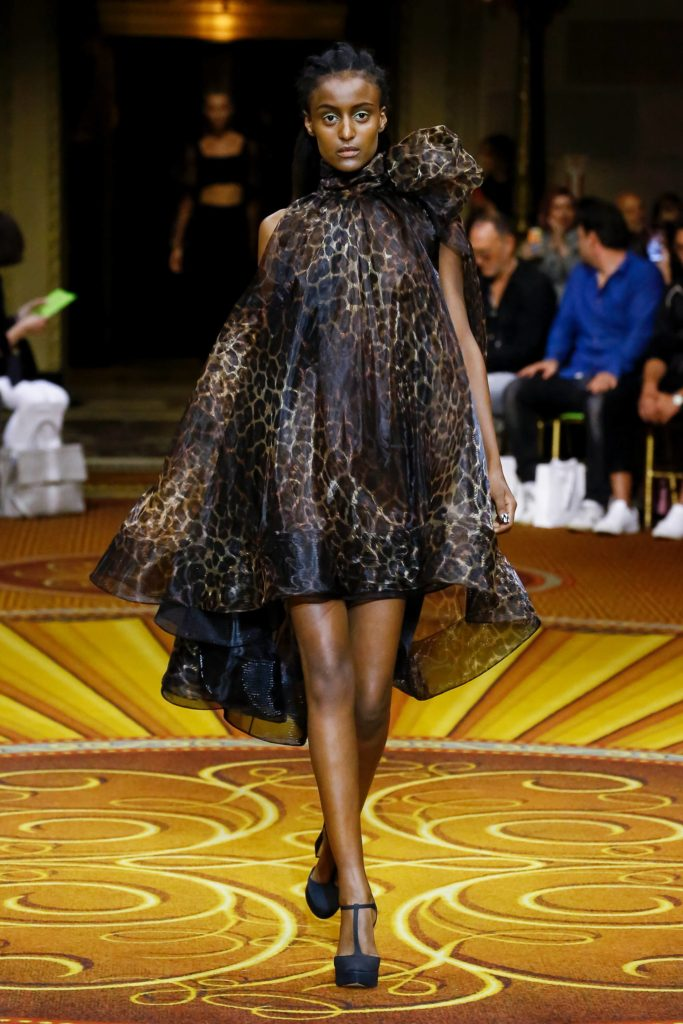Christian Siriano 2019 Spring Summer Collection Runway Model in Leopard Dress with Large Neck Bow