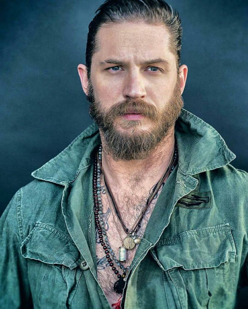 Actor Tom Hardy Looking Sexy and Rugged in Green Army Jacket and Cool Necklaces