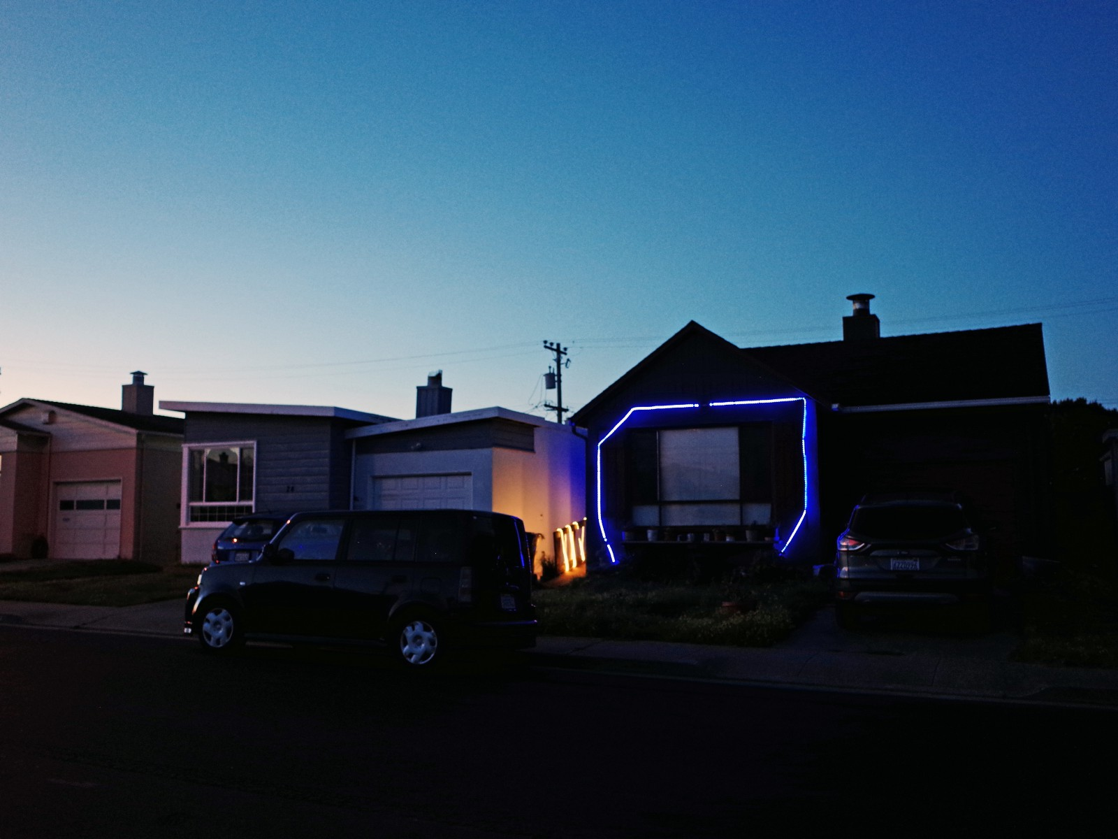 Todd Hido house with neon light frame