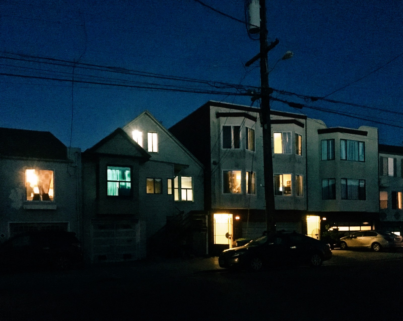 Todd Hido row of houses at night with lights on