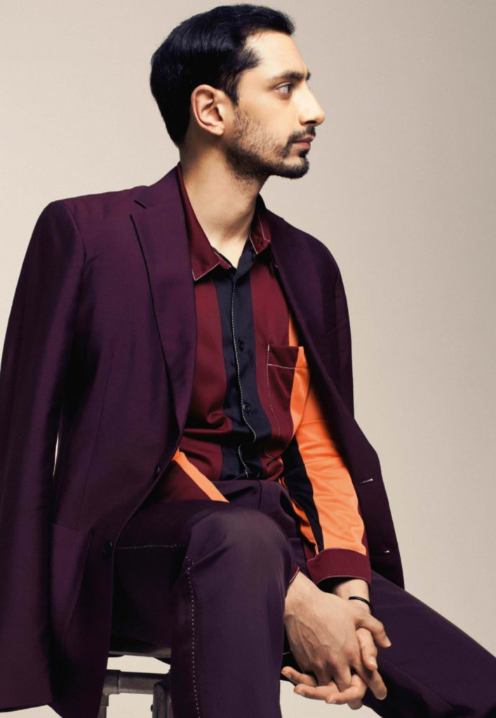 Profile of Actor Riz Ahmed Looking Fashion Forward in Maroon Suit
