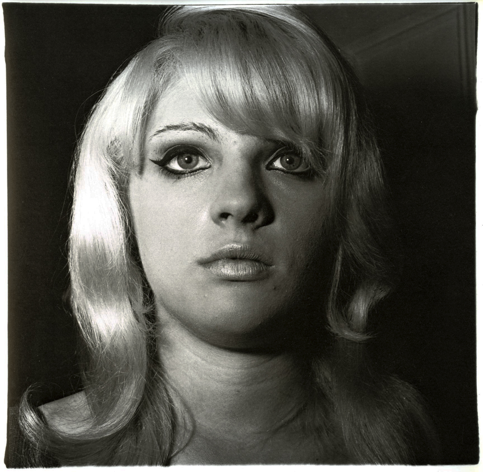 Diane Arbus photograph of a blonde woman with heavy eyeliner