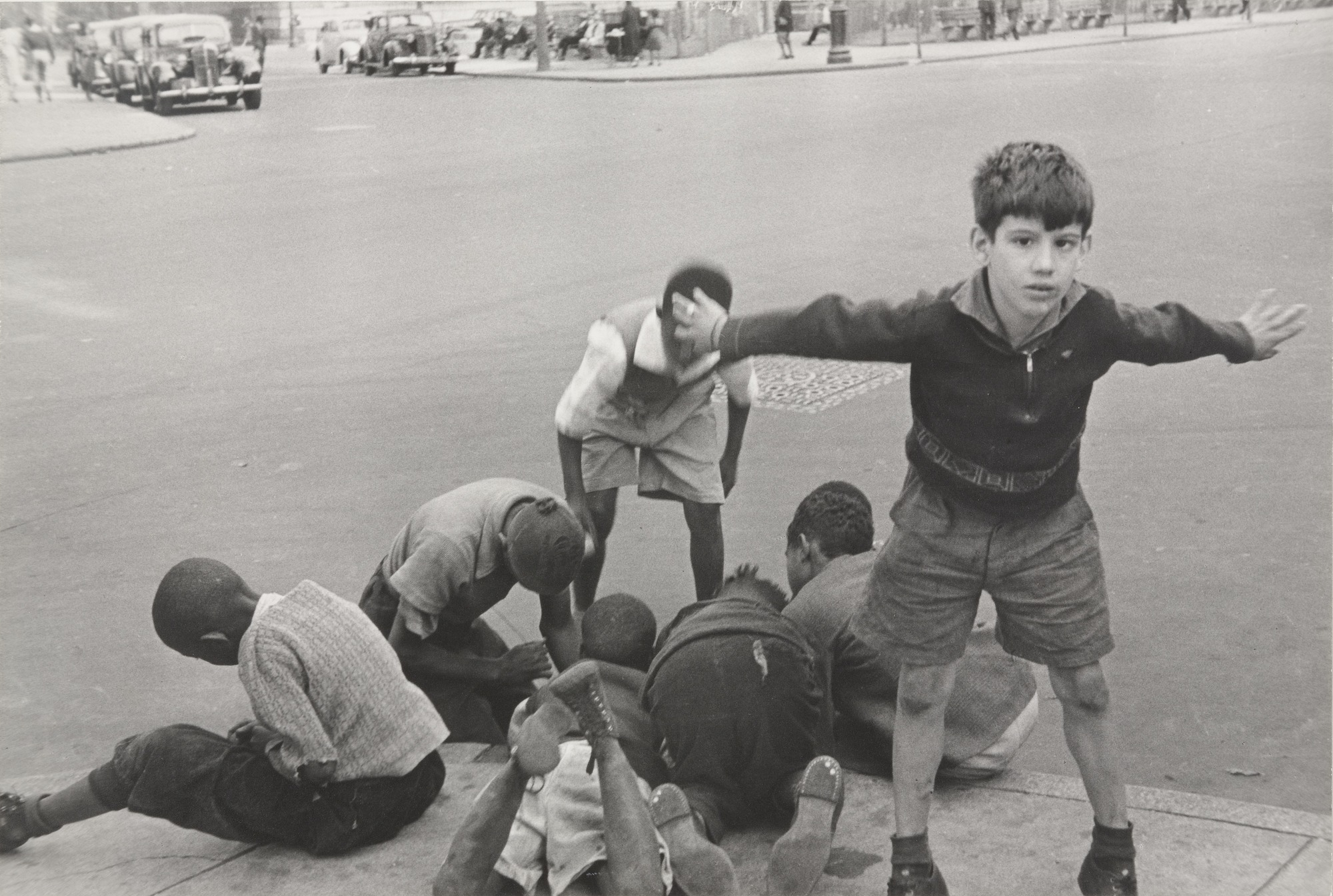 Boys playing on a street corner