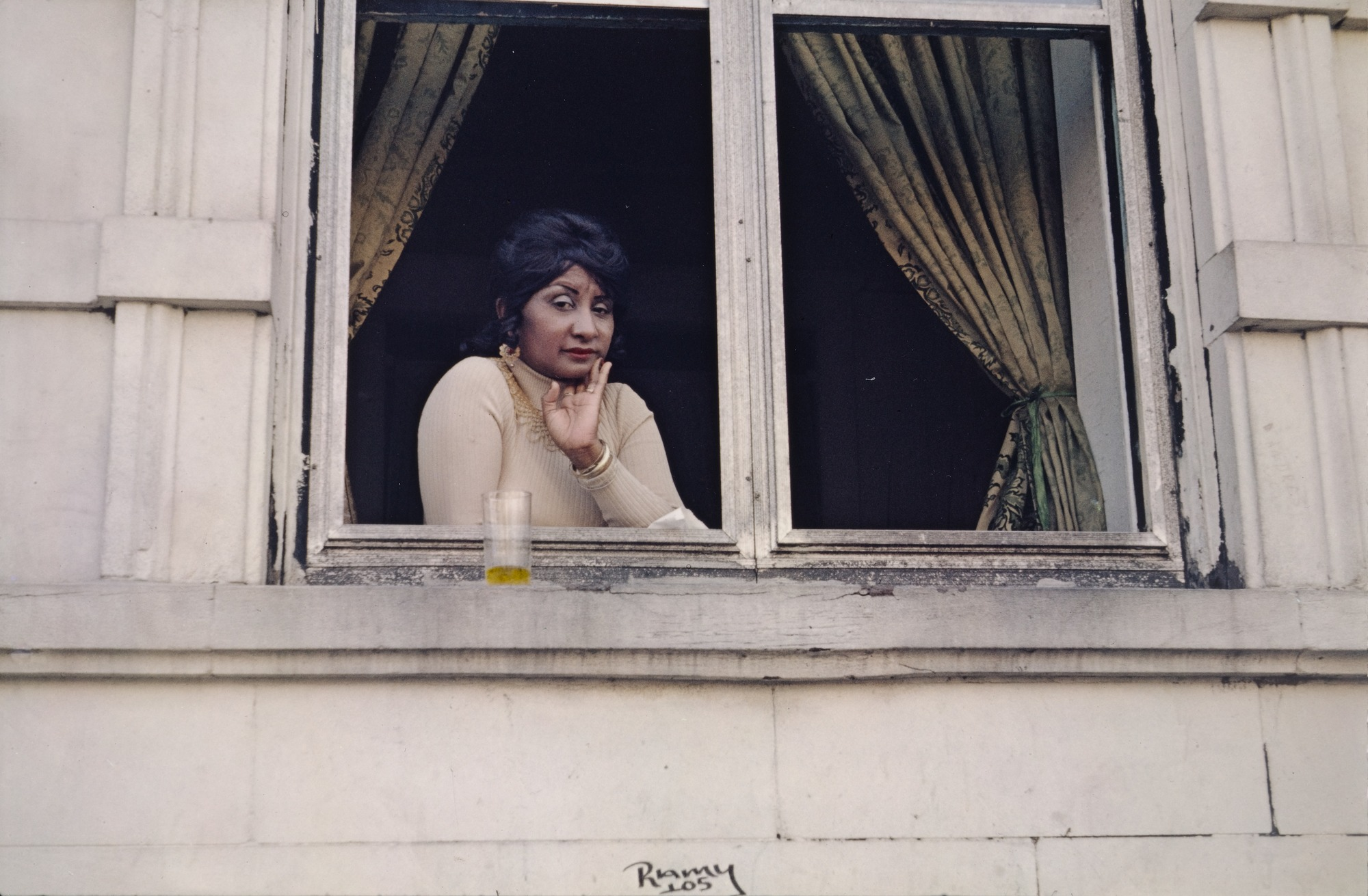 Woman in an apartment window, by Helen Levitt