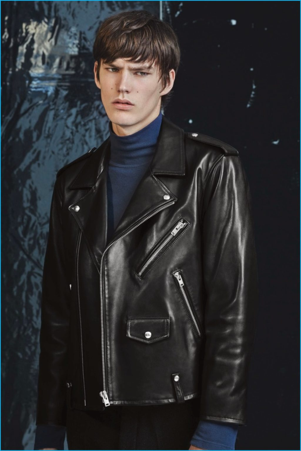 Male Model Wearing a Black Leather Motorcycle Jacket and Blue Turtleneck