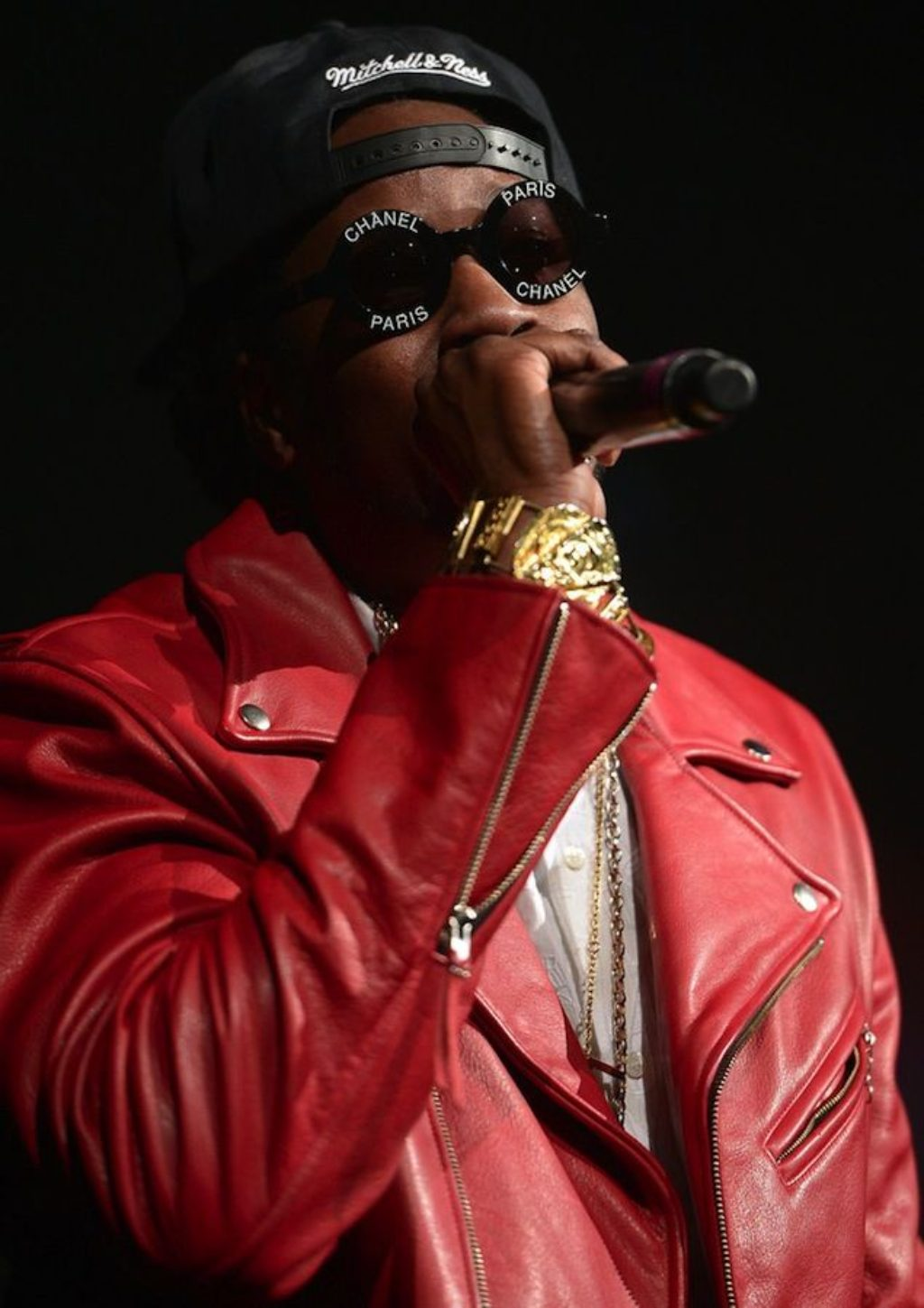 Kayne West Wearing A Red Leather Motorcycle Jacket and Chanel Sunglasses
