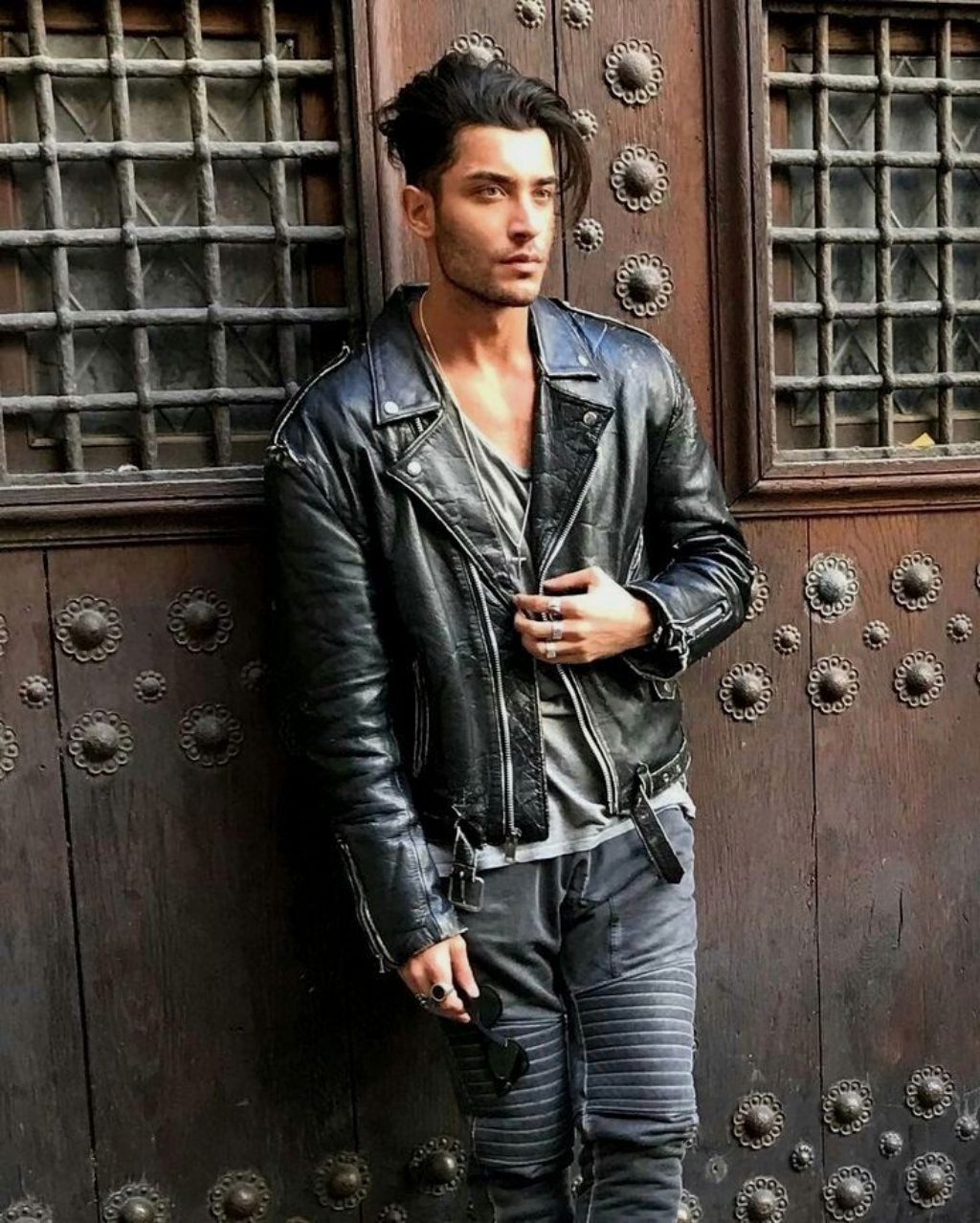 Sexy Male Model With Great Hair Wearing a Black Motorcycle Jacket