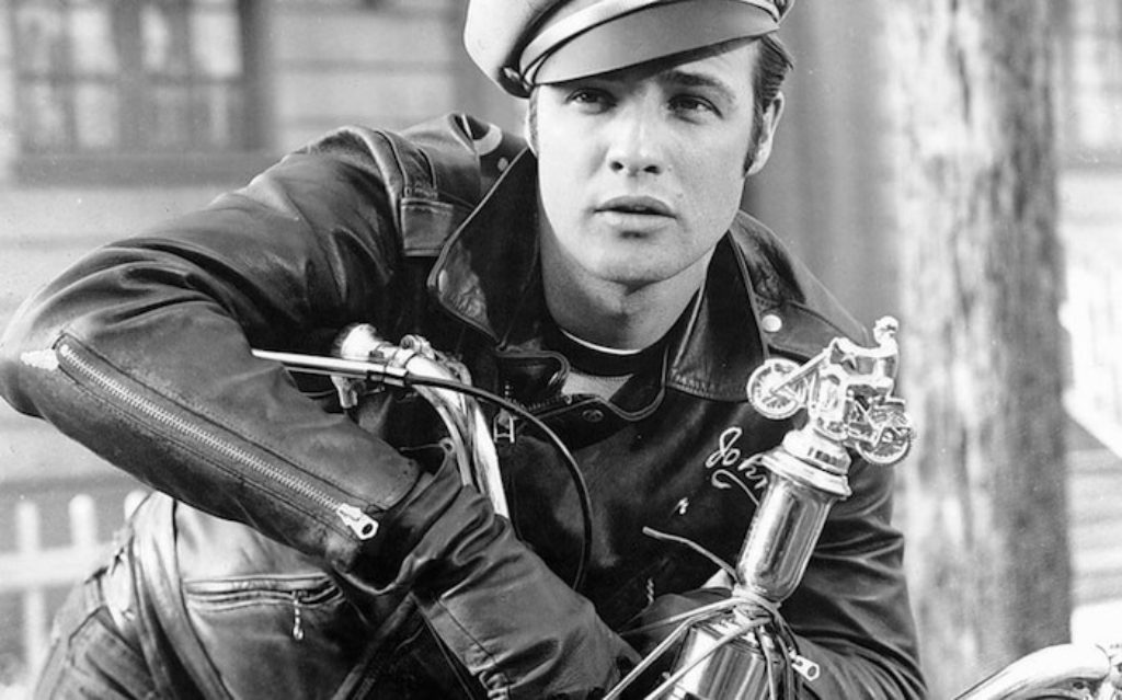the classic photograph of Marlon Brando on his motorcycle wearing the coolest motorcycle jacket and cap