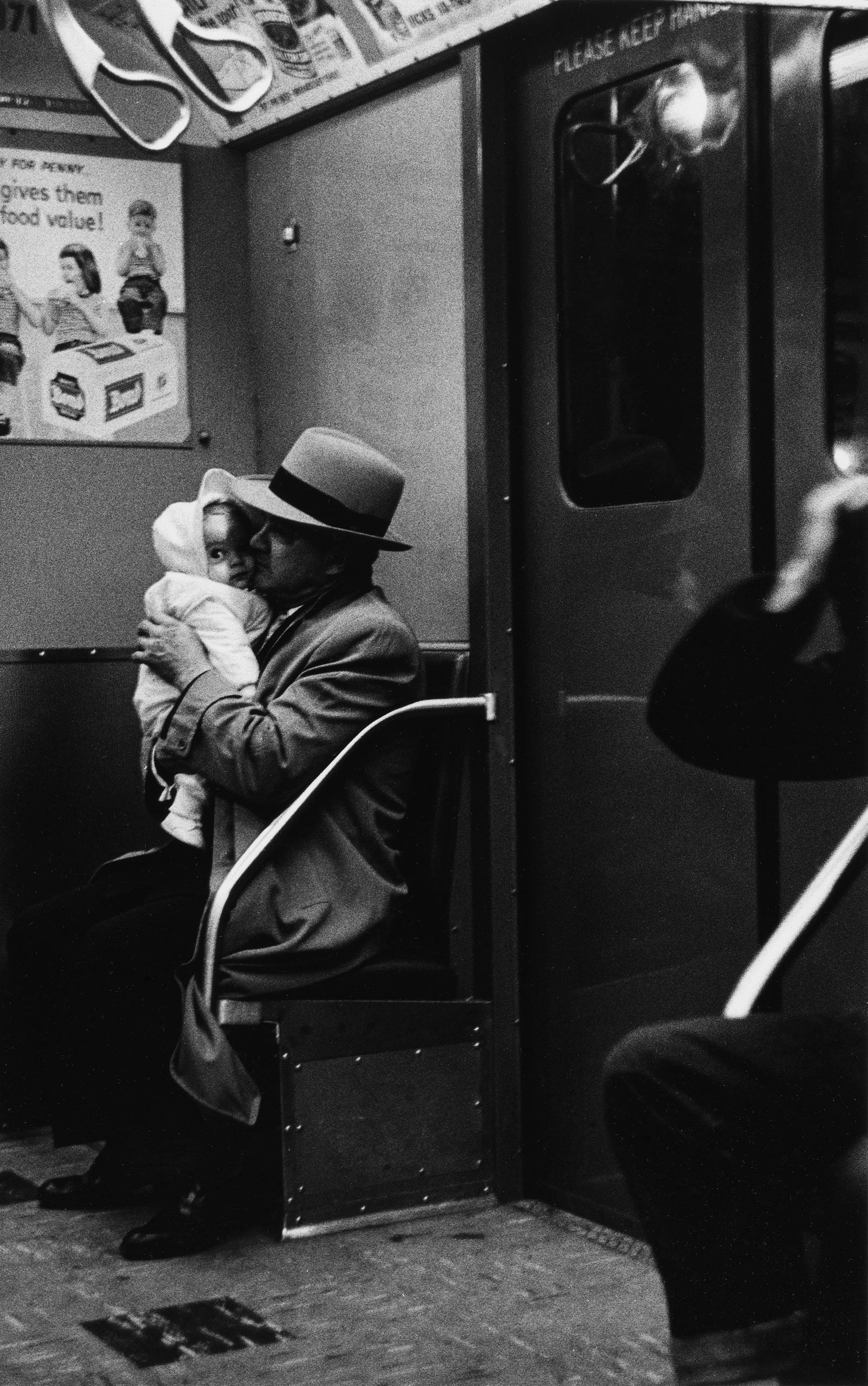 Diane Arbus photograph of a man and child in a subway car