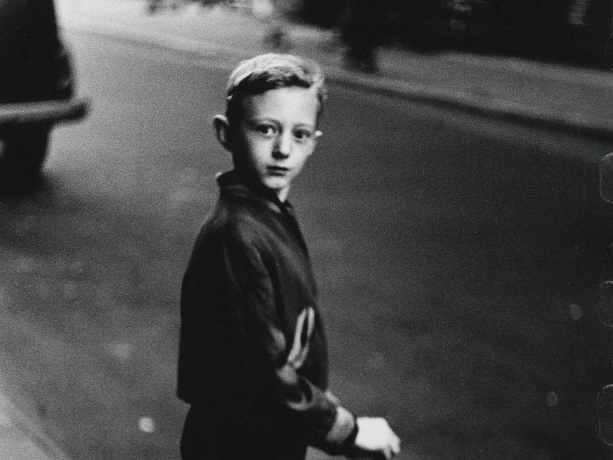 Diane Arbus photograph of a young boy on the street